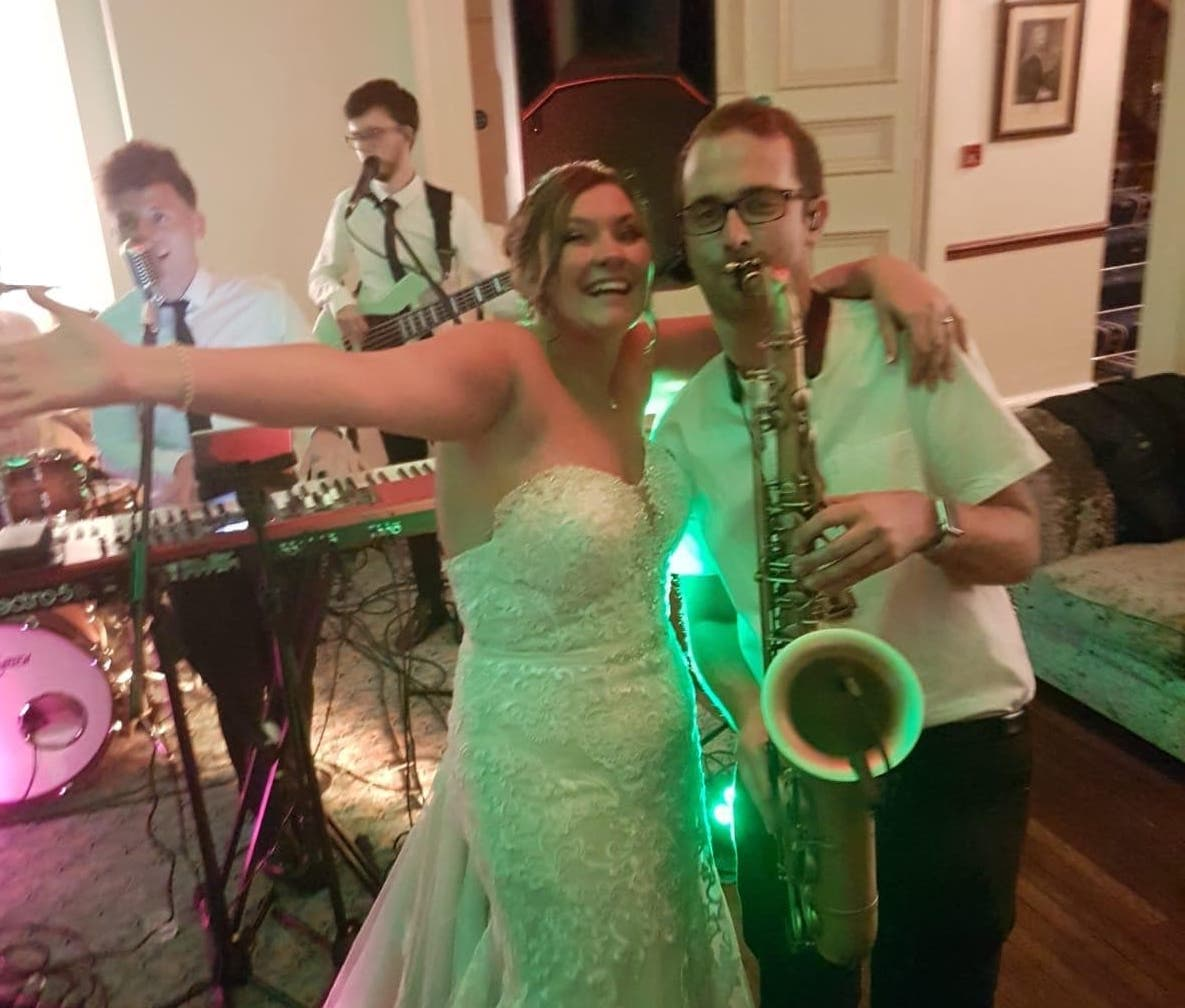 The Bride with Wandering Wings' Sax player