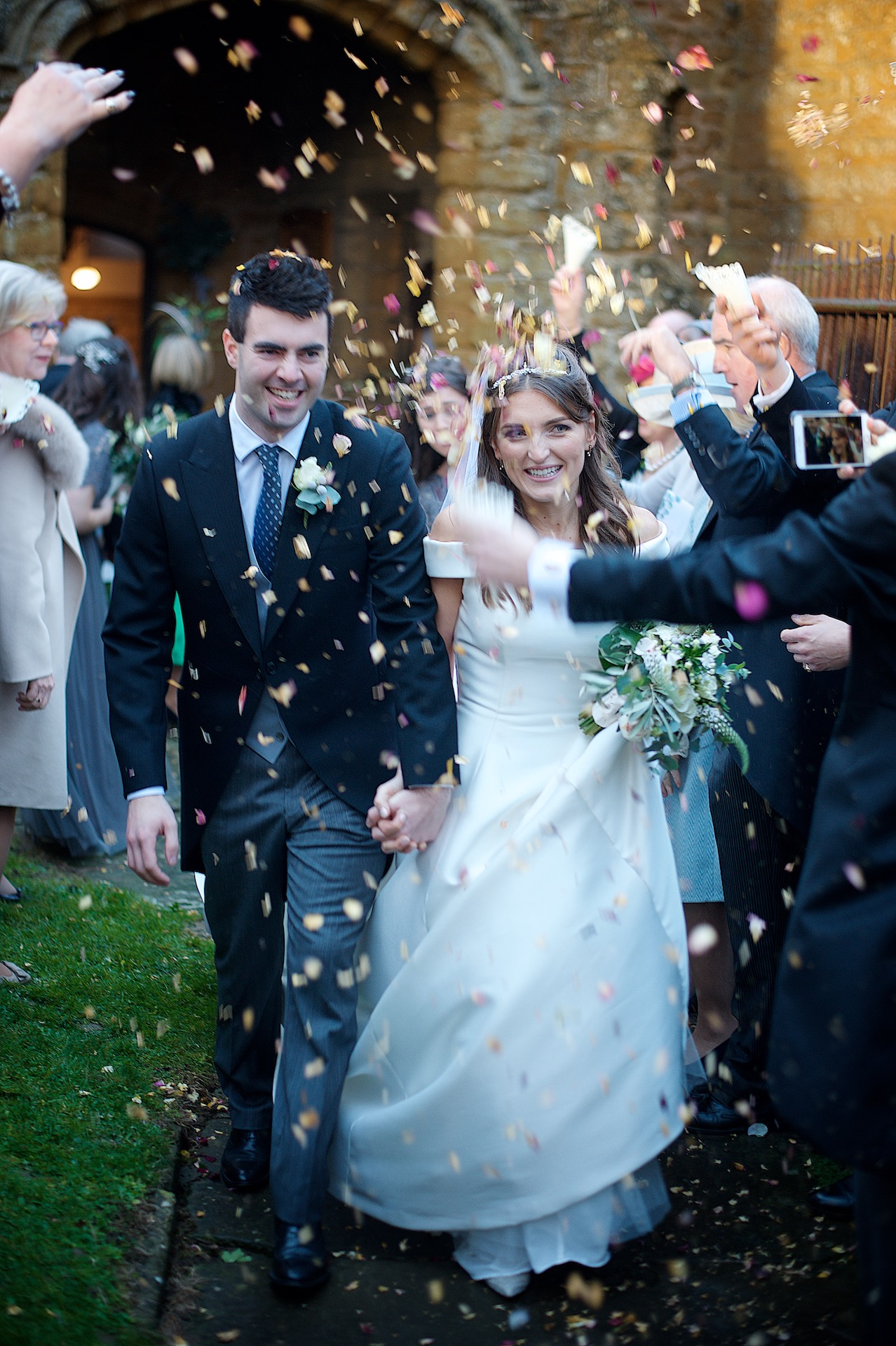 Bride and Groom Outside Church With Confetti