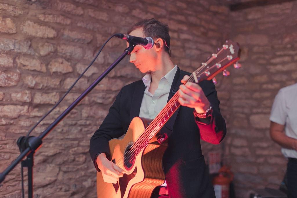 Wandering Wings Acoustic Guitarist