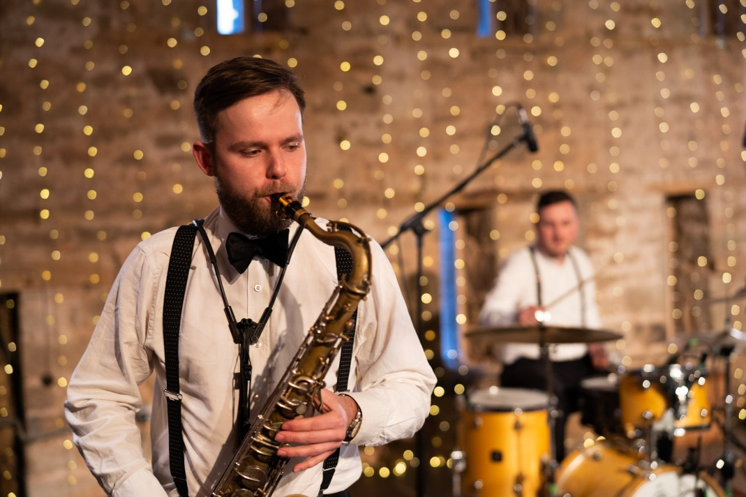 The band's saxophonist playing