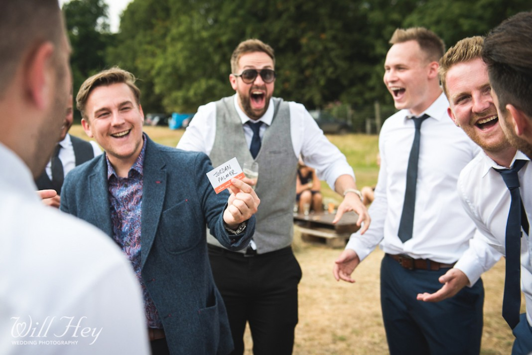 Wedding magician with a shocked group of male guests