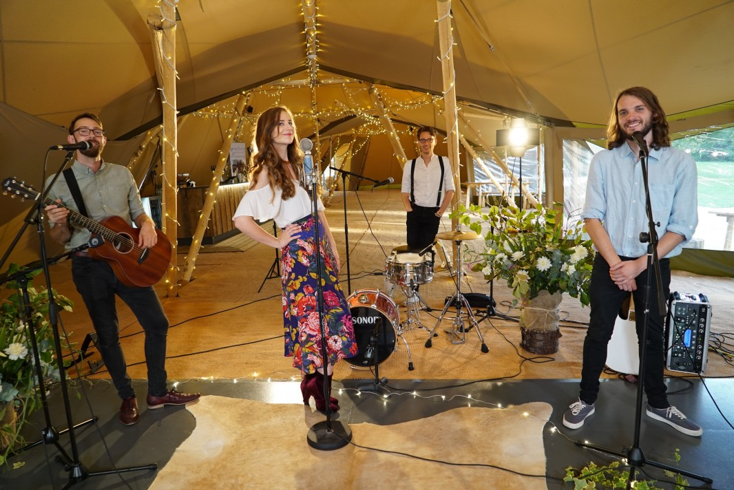 Four piece wedding band in a marquee